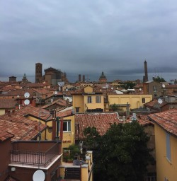 The rooftops of Bologna on a cloudy day